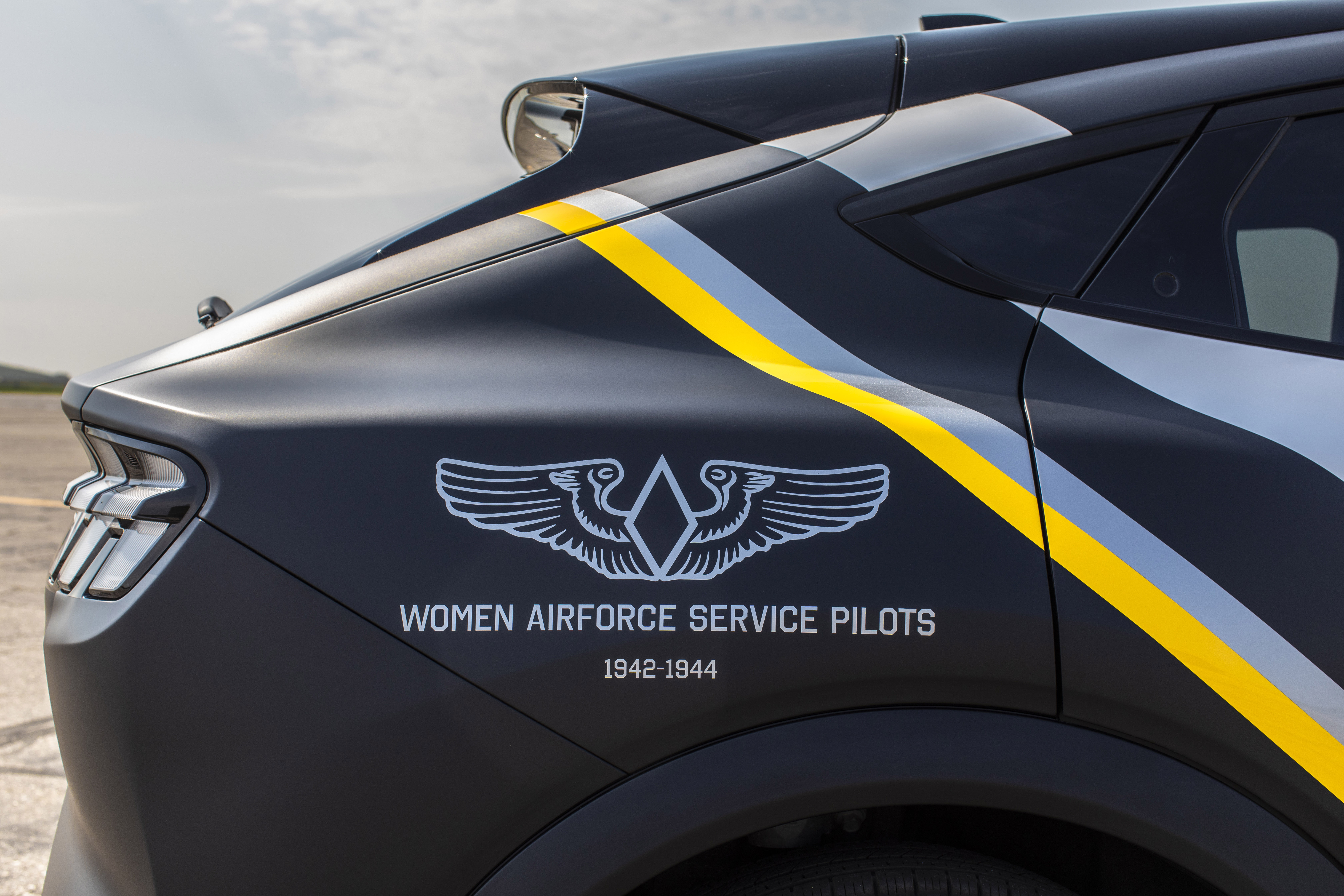In honor of the humble sacrifices of the Women Airforce Service Pilots, Ford today is announcing a one-of-one custom 2021 Mustang Mach-E inspired by the volunteer female pilots and the planes they piloted during World War II. It will be auctioned at the 2021 Experimental Aircraft Association (EAA) AirVenture air show on Thursday in Oshkosh, Wisconsin. Concept vehicle shown. Not for sale.